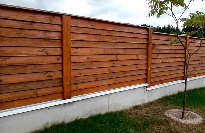Забор елочка на ленточном фундаменте